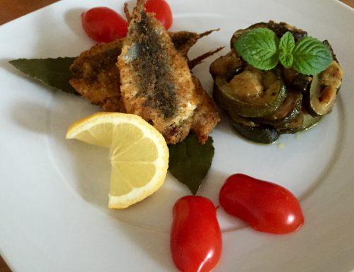 Sarde a Beccafico al modo Catanese cotte in forno con Zucchine alla Mentuccia……..